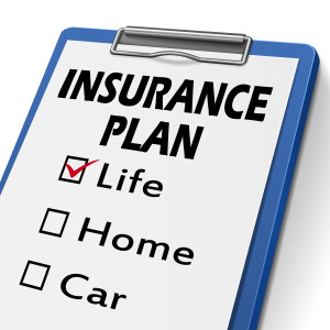 insurance plan clipboard with check boxes marked for life, home and car